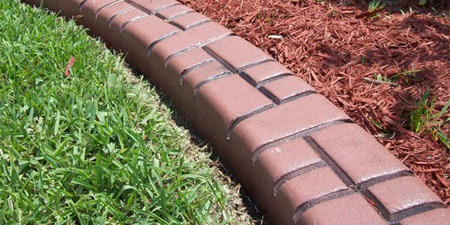 Squared border concrete curbing edging stained and stamped to custom requirements.