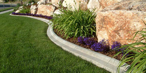Mower Edge concrete edging for landscaping curbing in the Rochester Minnesota area.